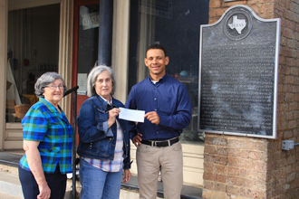 TVEC Energy Management Advisor Chris Walker, right, presents a grant check to Sarah Brown and Betty Hallowell from the Henderson County Historical Society.